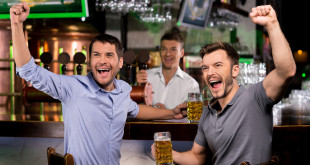 men cheering in bar